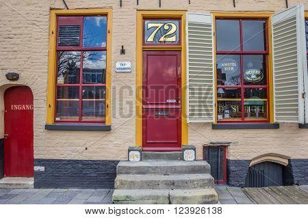 GRONINGEN, NETHERLANDS - MARCH 27, 2016: Entrance of old pub