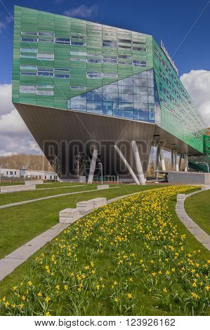 GRONINGEN, NETHERLANDS - MARCH 27, 2016: Spring flowers in front of The Linnaeusborg, the new building for Life Sciences of the University of Groningen. The building was opened in 2010