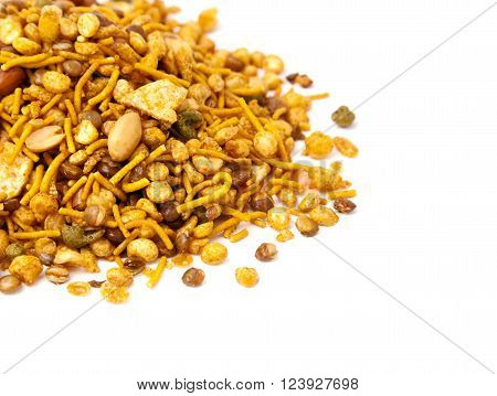 Pile of dry roasted Indian snack mix, isolated over white