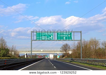 Big Road Sign With Directions To The City Of Trieste And Udine In The Great Italian Motorway