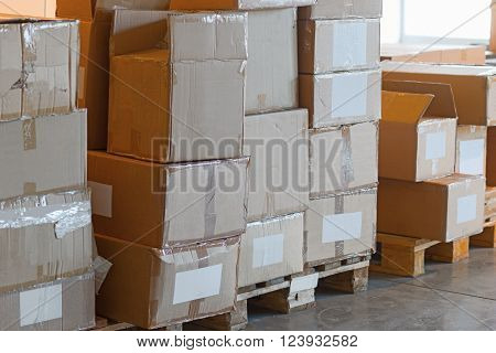 Storage area with stack of battered cardboard boxes