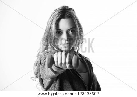 Attractive female fitness model isolated on a white background in sports wear with dumbells