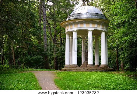 White classicism style arbor in a green summer park. Tukums, Latvia