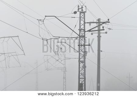 Railroad cable power lines in strong fog