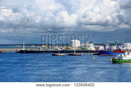 Tankers in cargo port terminal. Industrial sea landscape.