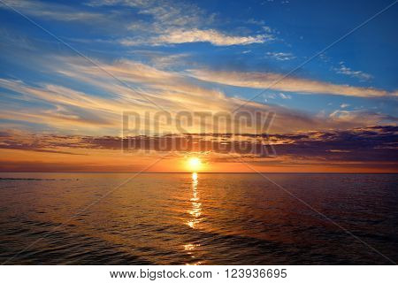Open Baltic sea at a beautiful sunset with colourful clouds