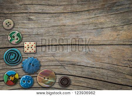 Retro Ornamental Vintage Buttons On A Rustic Wooden Table With Copy Space