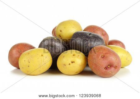 Pile of colorful fresh little potatoes over a white background