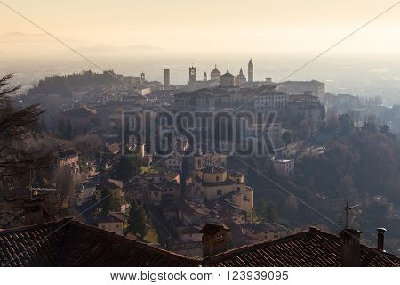 View over Old Town buildings in the ancient city of Bergamo, Lombardia, Italy on a misty winter day, taken from San Virgilio point.