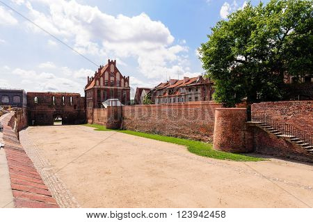 TORUN, POLAND - JULY 7, 2009: Gothic St. George guild house and the moat between old and new towns