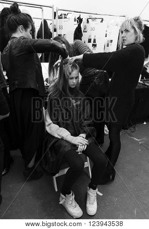 New York NY - February 13 2016: Olivia Mink prepares backstage for the Jill Stuart Fall 2016 fashion show during New York Fashion Week