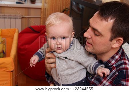 Father and baby boy in home