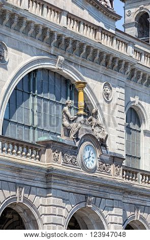 Zurich Switzerland - 3 July 2015: clock on the facade of the Zurich Main railway station. Zurich main railway station (German: Zurich Hauptbahnhof or Zurich HB) is the largest railway station in Switzerland.