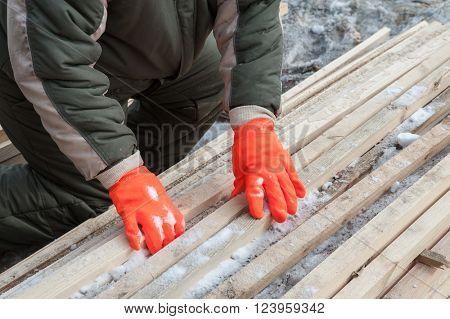 Carpenter working at sawmill, closeup photo