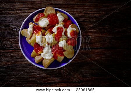 Tapas Patatas Bravas potatoe fries with tomato and mayonaise from Spain