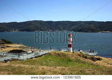 NIEBLA, CHILE - FEBRUARY 2, 2016: Lighthouse of the Niebla fort, Chile on February 2, 2016. The fort, located at the mouth of the Valdivia river, is part of the Valdivian fort system and was declared national monument in 1950