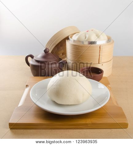 Pao Or Dim Sum With Chinese Tea On Background.
