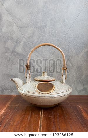 Chinese tea pot on wooden table. Copy space