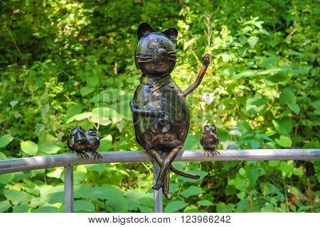 Lviv Ukraine - July 5 2014: Metal figures of funny cat and birds in Stryiskyi Park