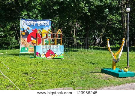 Game with big slingshot and  figures of angry birds in city park. Lviv, Ukraine