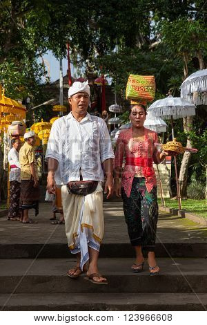 UBUD, INDONESIA - MARCH 2: Couple walks down the stairs during the celebration before Nyepi (Balinese Day of Silence) on March 2, 2016 in Ubud, Indonesia.