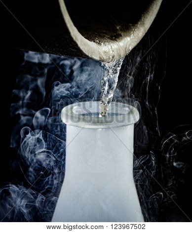 liquid nitrogen being poured from a beaker into a flask ** Note: Visible grain at 100%, best at smaller sizes