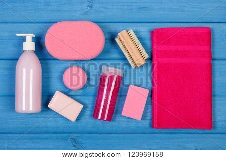 Cosmetics and accessories for personal hygiene in bathroom, soap, body scrub, towel, sponge, brush, pumice, concept of body care