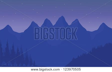 Silhouette of mountain with purple background at night