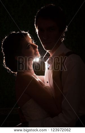 Bride Looking At Her Husband With A Light Behind