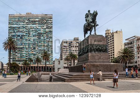 Montevideo, Uruguay - December 15, 2012: Plaza indepedencia with the statue of Jose Artigas in Montevideo, Uruguay. People can be seen in the image.