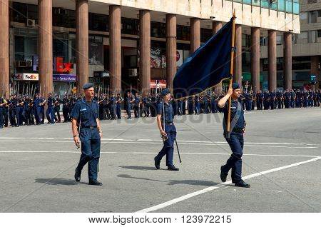 Montevideo, Uruguay - December 15, 2012: State Police march in the parade in the heart of downtown Montevideo in the Plaza Independencia, Montevideo, Uruguay.