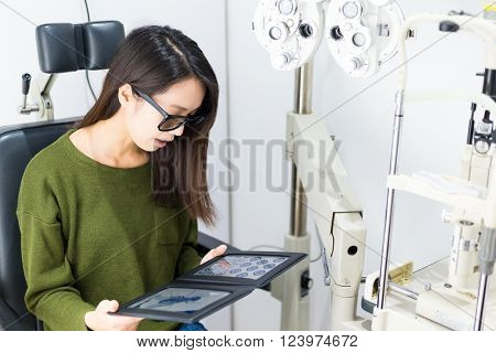 Woman checking the 3D vision on eye