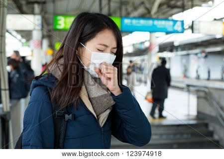 Woman got sick and wearing face mask at train station