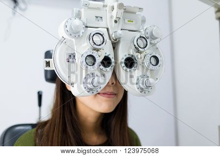 Woman doing eye test in medical office