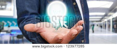 Businessman Holding Lightbulb