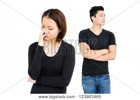 Young couple ignoring each other on white background