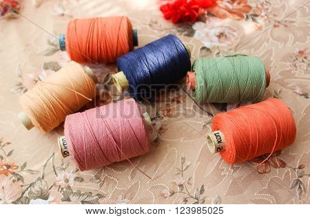 Skeins of sewing threads of bright  colors ** Note: Shallow depth of field