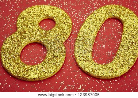 Number eighty golden color over a red background. Anniversary. Horizontal