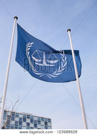 The Hague, Netherlands - March 27, 2016: The flag and the International Criminal Court at the new 2015 opened ICC building.