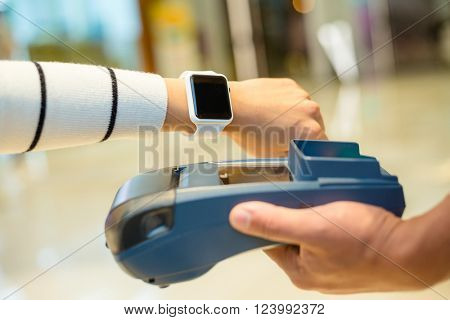 Customer paying by NFC inside shopping mall