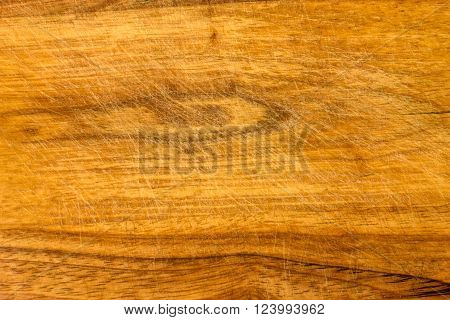 indented surface of the cutting board with a knife as a background