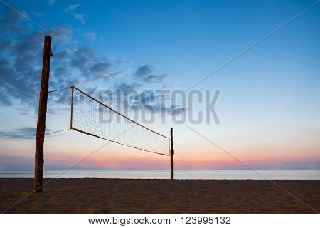 Sillhouette of beach volleyball net with sky sunset on the beach