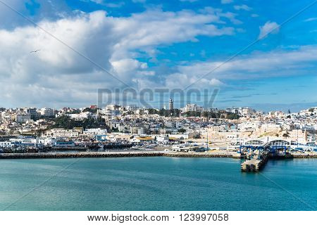 Ancient arabic city panorama view in Morocco Africa. View at Port of Tangier on a sunny day against blue cloudy sky, image for travel tourism concept blog business website