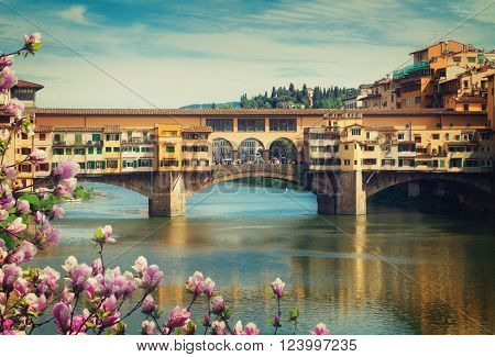 famous bridge Ponte Vecchio over river Arno at spring day, Florence, Italy, retro toned