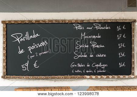 Restaurant menu in oyster producing village Bouziges on French coast