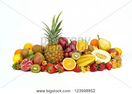 fresh tropical fruits against white background