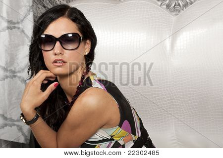 Adorable brunette lady in sun glasses