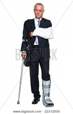 Photo of a badly injured businessman walking on cructhes carrying a briefcase, isolated on a white background.