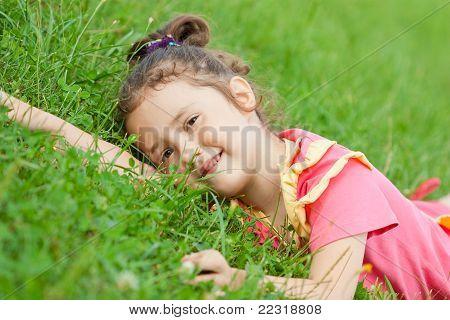 The Girl Lies On A Grass