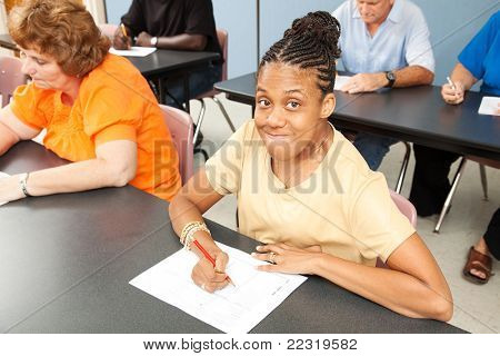 Young woman with cerebral palsy in college class.
